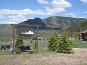 Sign and pine trees at Neighborhoods at Youngs Peak